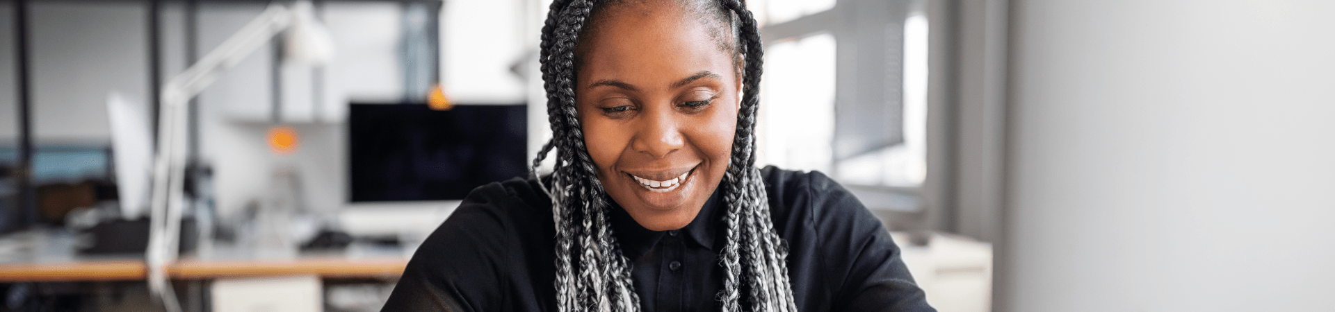 African lady with grey hair smiling