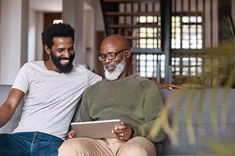 African American people looking on tablet computer