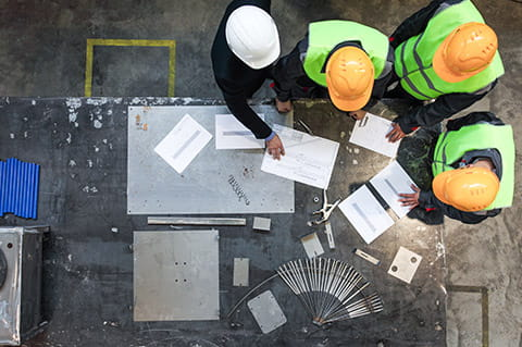 Construction men looking at plans