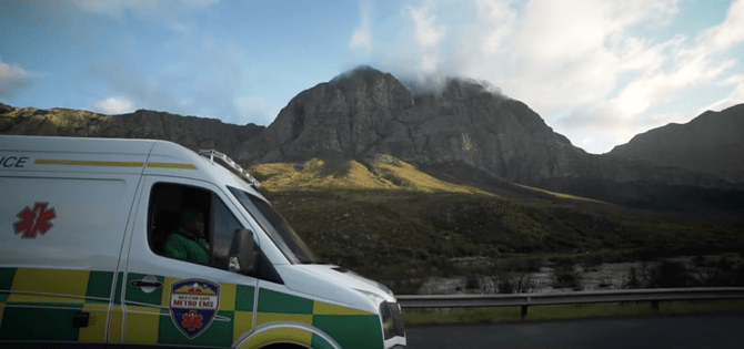 EMS vehicle driving by table mountain
