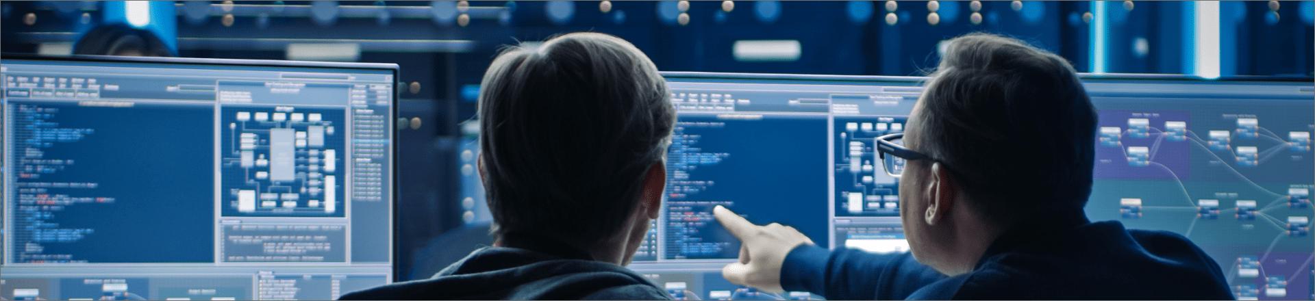 Two men monitoring a computer screen