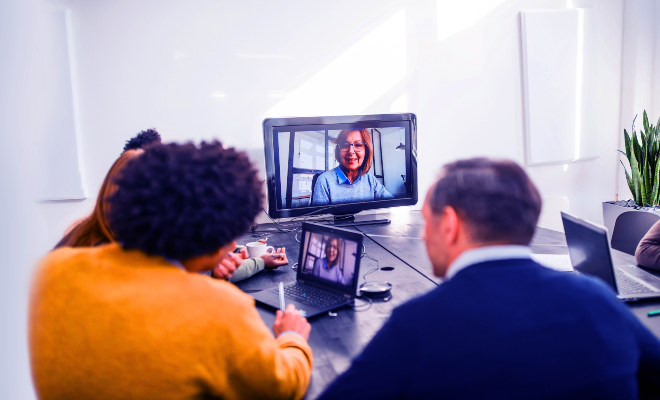 People in a meeting room during a conference call