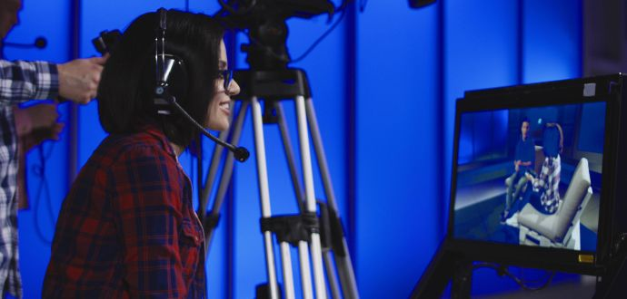 Television production person with headphones