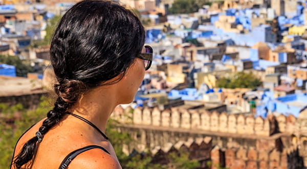 Woman with sunglasses looking out over city