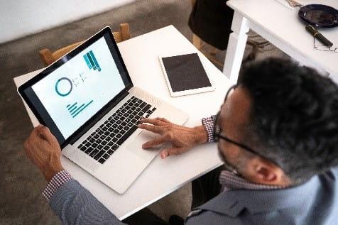 Business it man using laptop