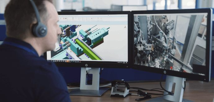 Automotive technician sitting at computer screens
