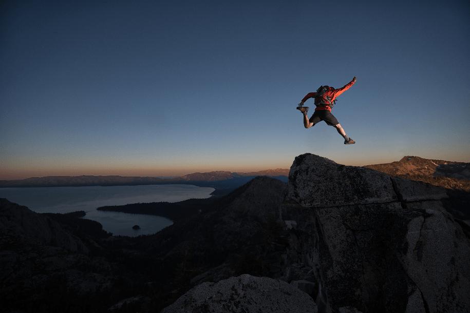 Man jumping rocks