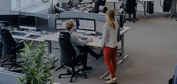 People sitting and standing in an office environment