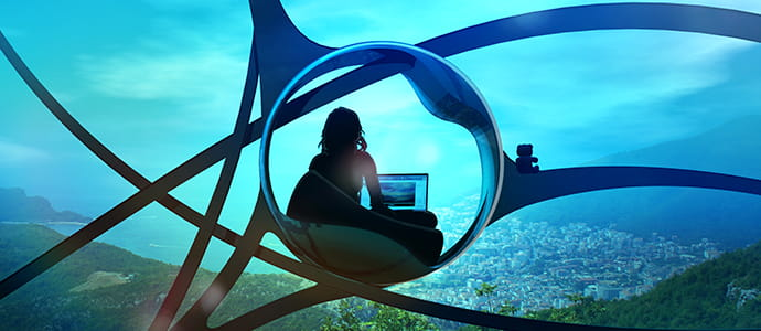 Woman working on a laptop sitting in a glass bubble