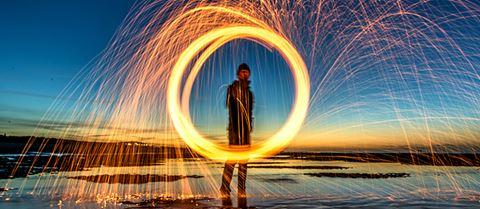 Man making a circular light trail