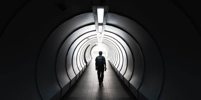 A person walking down a tunnel