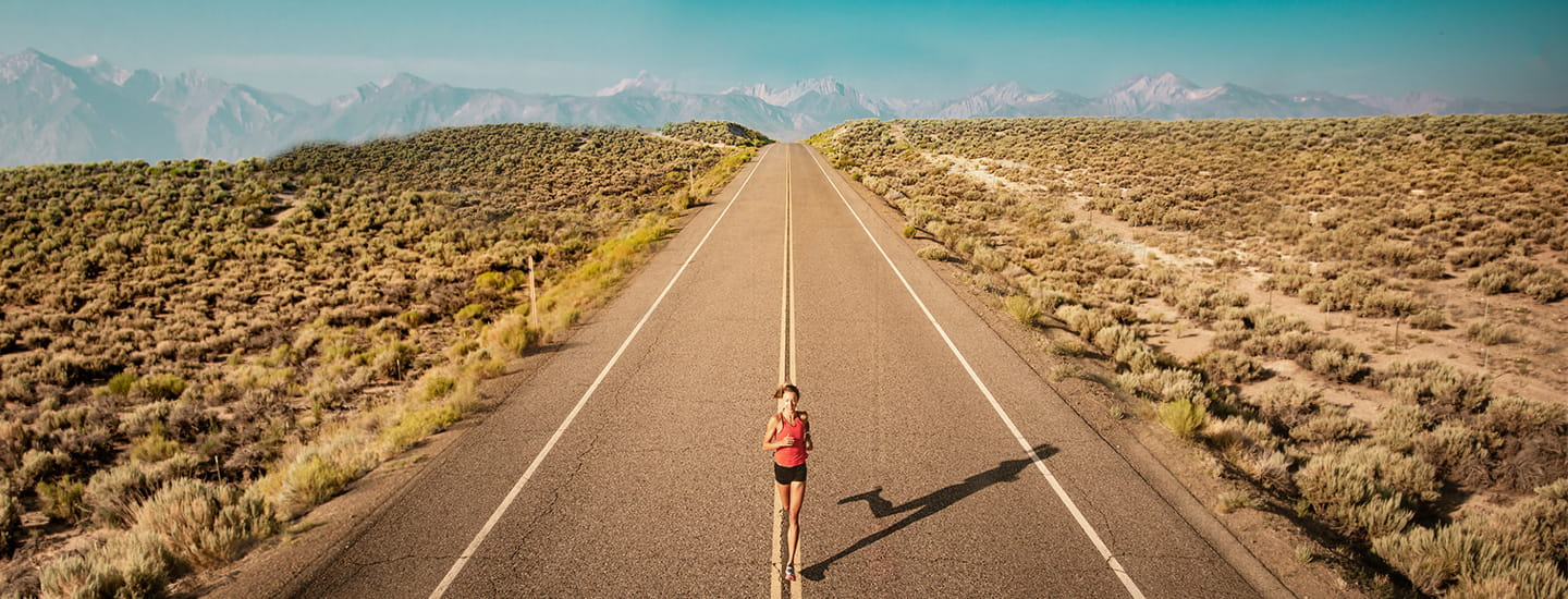 A person running down an empty road