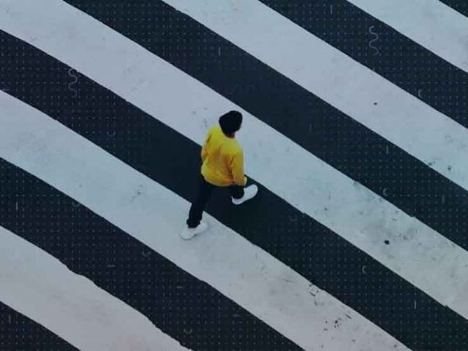 A person walking over a road crossing