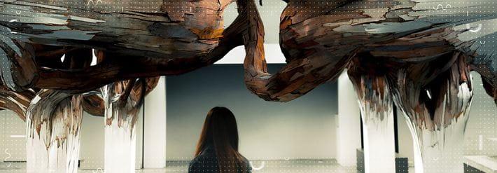A woman's head as she walks between art installations