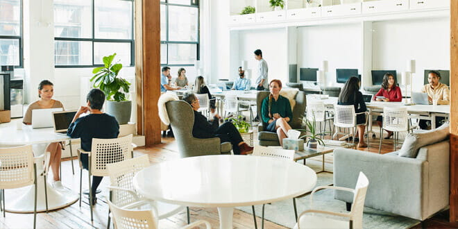 An open plan office with colleagues collaborating