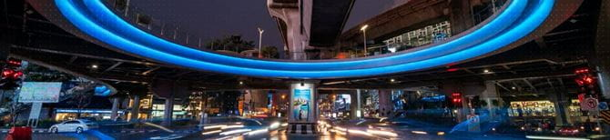 Street at night with a brightly lit arc overhead