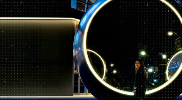 Woman standing at a large circular object