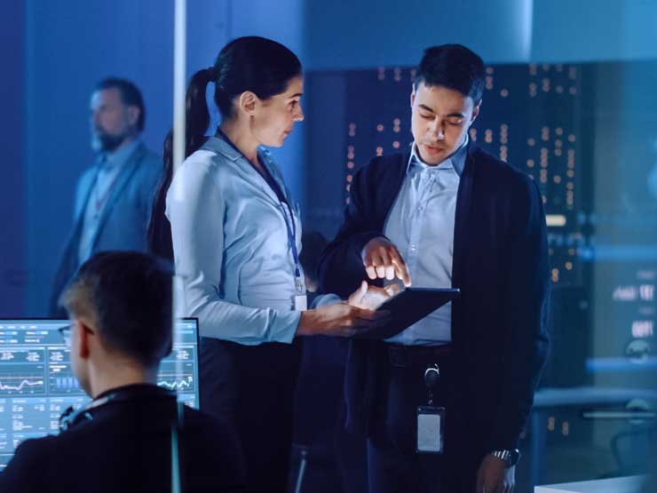 Business professionals at the data center building