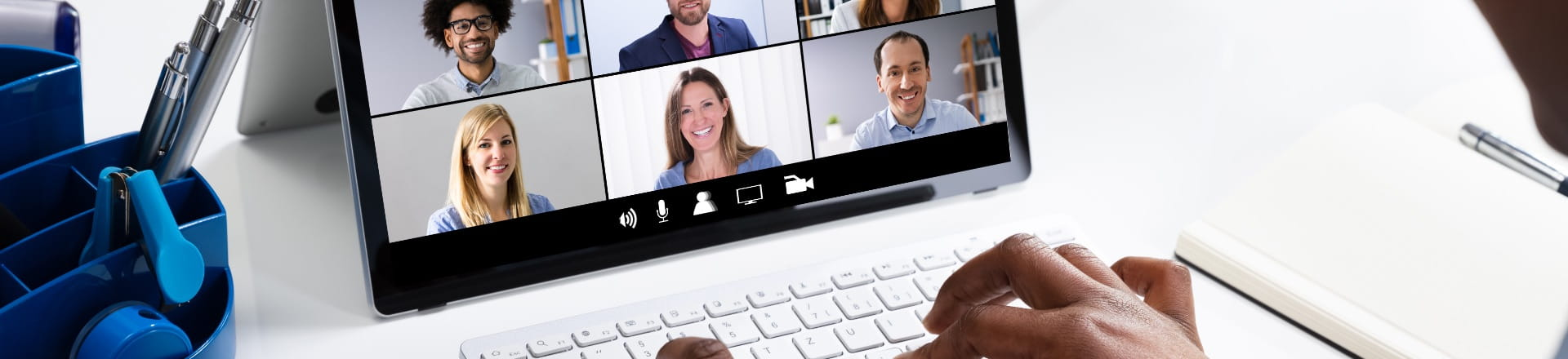 A persons laptop with a video conference happening