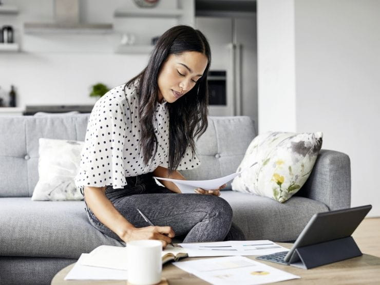 Woman working on laptop on a coffee table