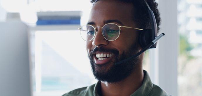 Smiling man wearing a headset