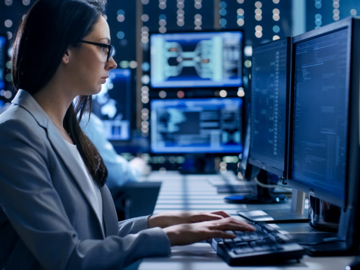 Business professional working at the data center desk