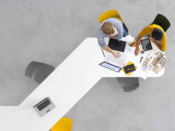 Aerial view of two people at a desk