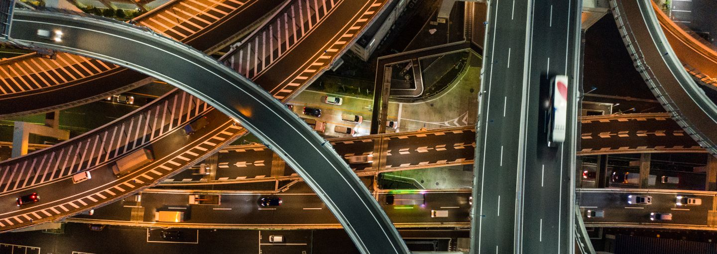 A picture of a connected high way at night