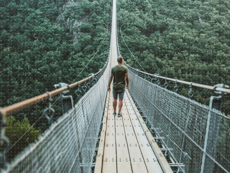 A person walking over a bridge