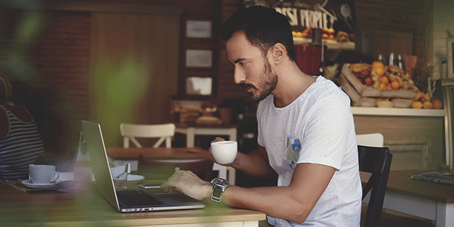 A man on his laptop while working from home for business continuity