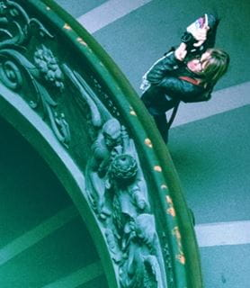Photographer taking photos on a spiral staircase