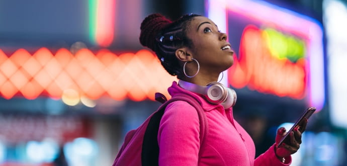 Lady with headphones looking up