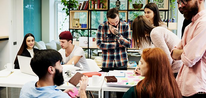 Colleagues collaborating in an open office space