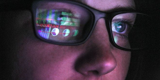 Spectacles reflecting a computer screen