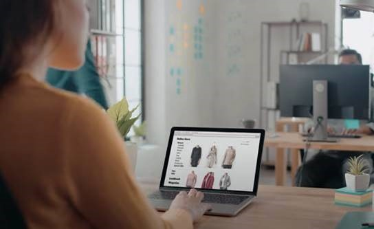 Woman looking at online shopping website
