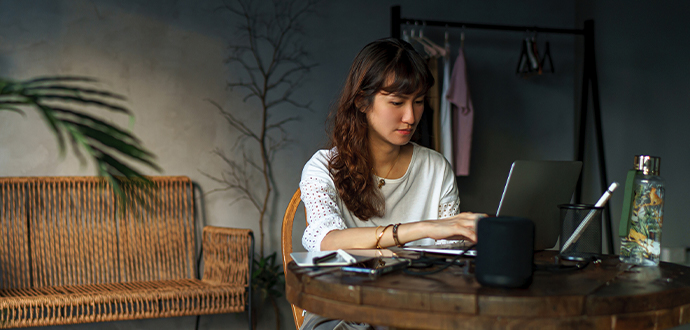 Woman sitting at a desk working on her laptop