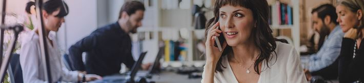 Woman talking on her mobile in an office