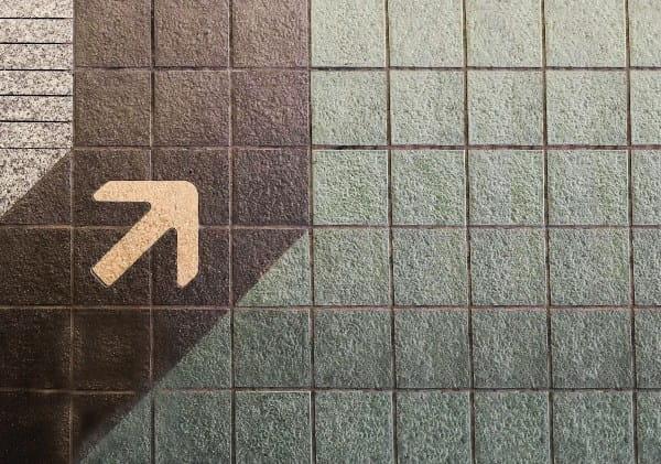 An arrow pointing at bricks