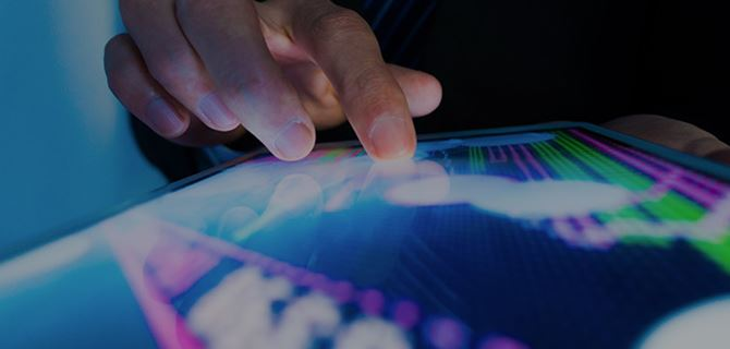 Hand touching a graph on a tablet screen
