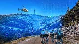 A helicopter flying over cyclists at the Tour de France